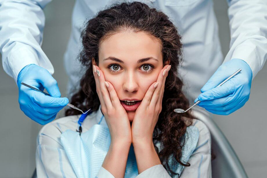 scared woman at dentist